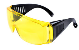 Safety glasses. Photo  yellow protective spectacles on white background isolated, close up full face Royalty Free Stock Photo