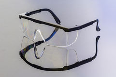 Safety glasses on reflection Royalty Free Stock Image