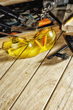 Safety glasses and tools on the workbench stock photography