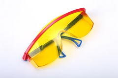 Safety glasses for work. Eye protection during operation on a white background . Stock Image
