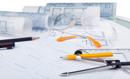 Safety glasses and writing equipment of architect. On working table Stock Images