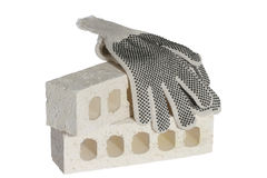 Safety gloves. Draped on white bricks - Personal Protective Equipment Royalty Free Stock Image