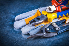 Safety gloves with nippers pliers and tin snips on Stock Images