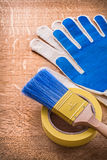 Safety gloves with paint brush on duct tape Stock Photo