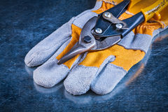 Safety gloves with tin snips on scratched vintage Stock Image
