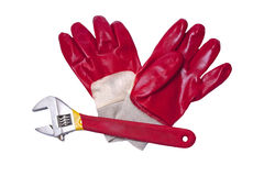Safety gloves with a  wrench Stock Image