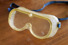Safety goggles. Plastic safety goggles covered in grease and dirt royalty free stock photos