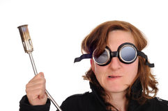Safety goggles, blowtorch. Person with safety goggles and Royalty Free Stock Images