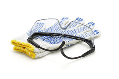Safety goggles and cotton gloves Royalty Free Stock Image
