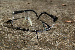 Safety Goggles On Rough Concrete Royalty Free Stock Photos