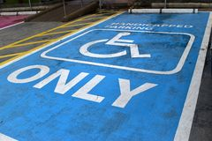 Safety. Handicapped parking in petrol station Stock Photos