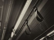 Safety handrails in transport. Modern handrails for passengers in a public transport car Stock Photo