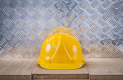 Safety hard hat wooden board channeled metal sheet construction. Concept royalty free stock photos