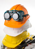 Safety hat and goggles glasses isolated Stock Images