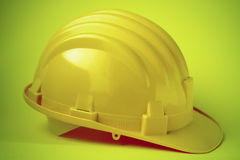 Safety helmet. Side view of yellow safety helmet on colorful background Royalty Free Stock Photography