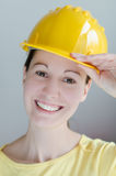Safety helmet. Confident construction engineer in yellow safety helmet royalty free stock image