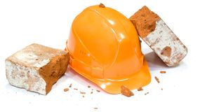 Safety helmet. The brick was broke about a helmet stock photos