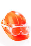 Safety helmet. An orange safety helmet with protective goggles Stock Image