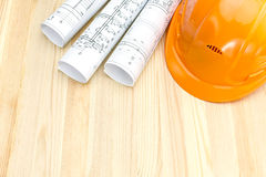 Safety helmet and architectural drawings Stock Photo