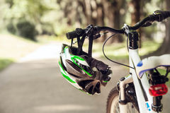 Safety helmet on the bicycle handlebar Stock Images