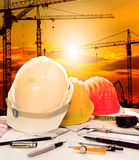 Safety helmet on engineer working table and construction site background Stock Images