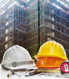 Safety helmet and engineering working tool against building cons Royalty Free Stock Images
