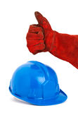 Safety helmet and hand with red glove expressing positivity with Royalty Free Stock Photo