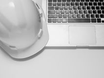 Safety helmet and laptop stock photos
