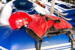 Safety helmet and life jacket, essential safety kit for canoeing and kayaking activities Royalty Free Stock Images