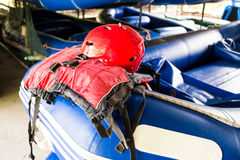 Safety helmet and life jacket, essential safety kit for canoeing and kayaking activities Royalty Free Stock Photos