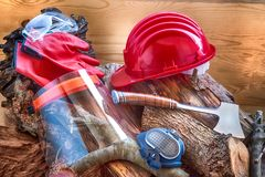 Helmet safety for the lumberjack and other objects for his protection and his work. Safety helmet of the woodcutter and other objects, for protection, essential Royalty Free Stock Image
