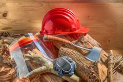 Helmet safety for the lumberjack and other objects for his protection and his work. Safety helmet of the woodcutter and other objects, for protection, essential Stock Photo