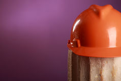 Safety helmet on a purple background Royalty Free Stock Photo
