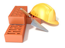 Safety helmet with rectangular perforated bricks and trowel Royalty Free Stock Images