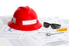 Safety helmet, safety goggles, and tools. royalty free stock images