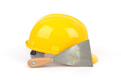 safety helmet and stainless steel scraper Royalty Free Stock Photo