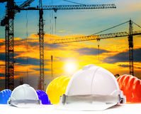Safety helmet and structure of high crane in construction site a Stock Photos