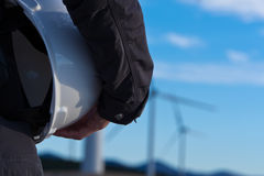 Safety helmet and wind turbines in the background Stock Image