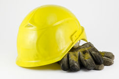 Safety helmet and work gloves. Safety helmet with gloves on white background Royalty Free Stock Photos