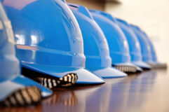 Safety helmets. On a construction site placed in a row Stock Photos