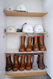 Safety helmets and boots Stock Photos
