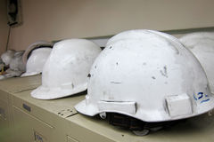 Safety helmets. On manufacturing site Royalty Free Stock Images