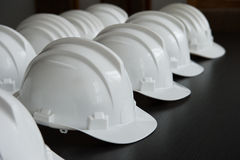 Safety helmets for protection. Safety helmets,for protection near a construction site placed in row Stock Photo