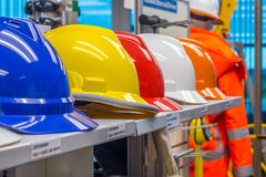 Health and safety products on display at a hardware shop. Safety helmets on a shelf of a hardware supplier`s shop royalty free stock photo