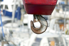 Safety hook, boat crane at the marina, protected with red coatin. G Royalty Free Stock Images