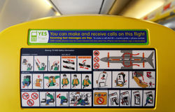 Safety informations panel on a boeing. Showing what you need to do in case of an emergency landing and advising you about the use of your mobile phone while on Stock Photo