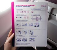 Safety Instruction Card on an Airplane. `Skopje, Macedonia - 04.25.2018: Wizz Air Safety Instruction Card on an Airplane stock images