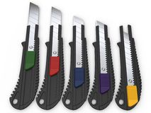 Safety knives with snap different coloured retract buttons Royalty Free Stock Images