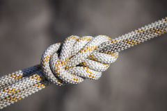 Safety knot, white rope royalty free stock photo