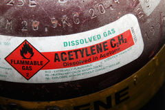 Safety label. Safety label on Acetylene gas bottle for burning and welding in an engineering workshop Royalty Free Stock Photo